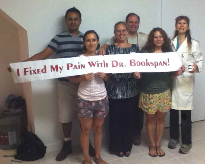 "ALT =[""Dr. Jolie Bookspan: Dr. Bookspan with students of classes to fix their pain.""]"