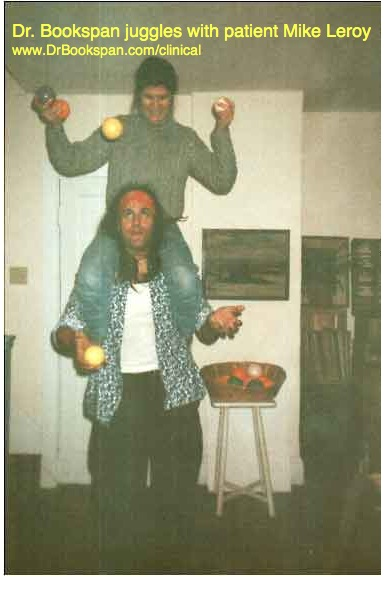 "ALT =[""Dr. Jolie Bookspan: Dr. Bookspan juggling with juggler Mike LeRoy after fixing his neck and shoulder pain.""]"