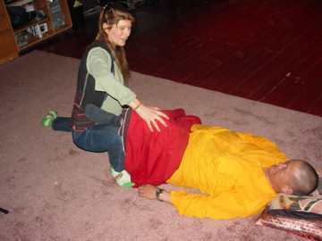 "ALT =[""Dr. Jolie Bookspan: Showing Thai massage techniques to Senior Monk Lama Tenzing of the Tibetan Medical School""]"