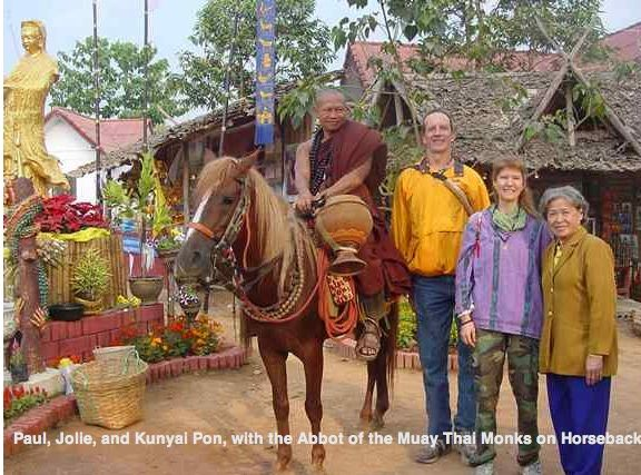 "ALT =[""Dr. Jolie Bookspan: WIth husband Paul meeting the Horseback Muay Thai Monks of Thailand""]"